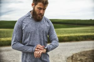 Runner with smartwatch listening to music