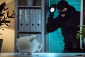 Burglar entering an office