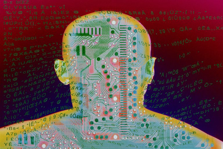 Outline of human's head with circuit board and HTML text