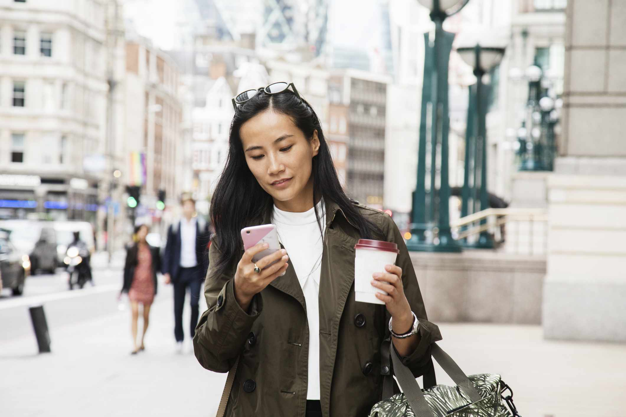 Asian woman looking at her phone
