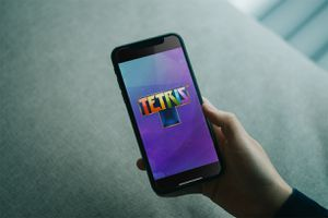 Hand holding Tetris on iPhone