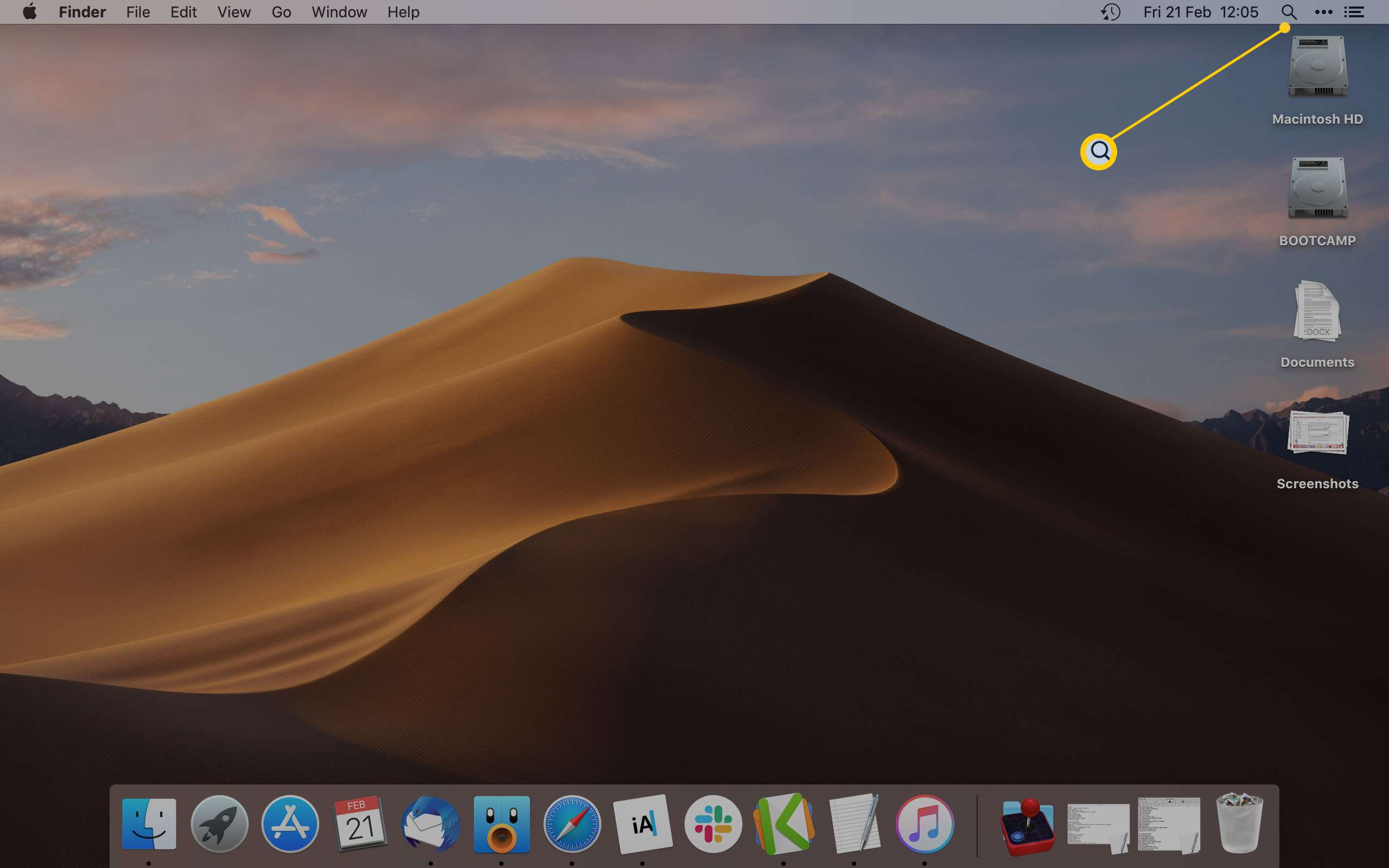 Mac home screen with magnifier glass icon highlighted