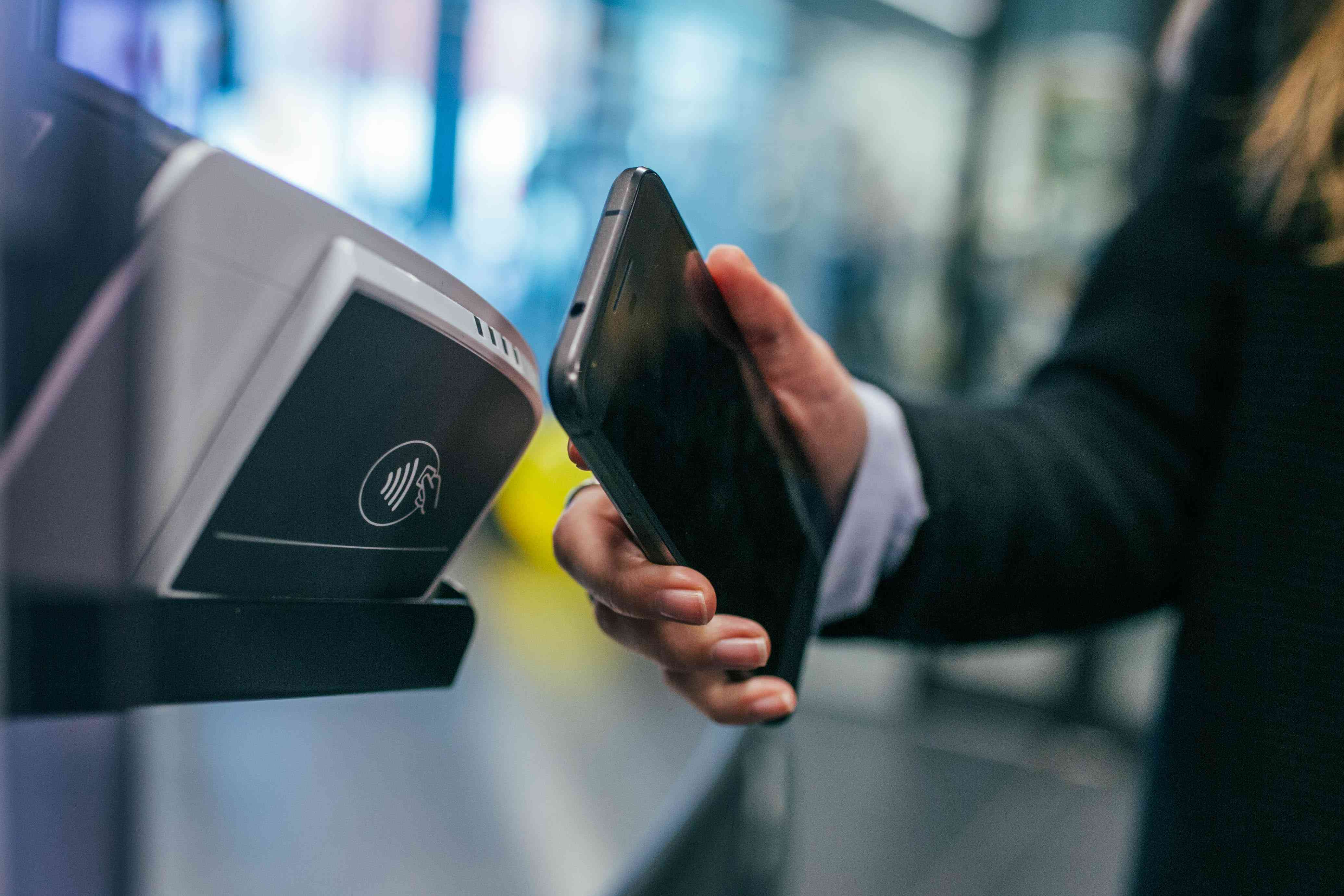 Someone using a mobile payments terminal.