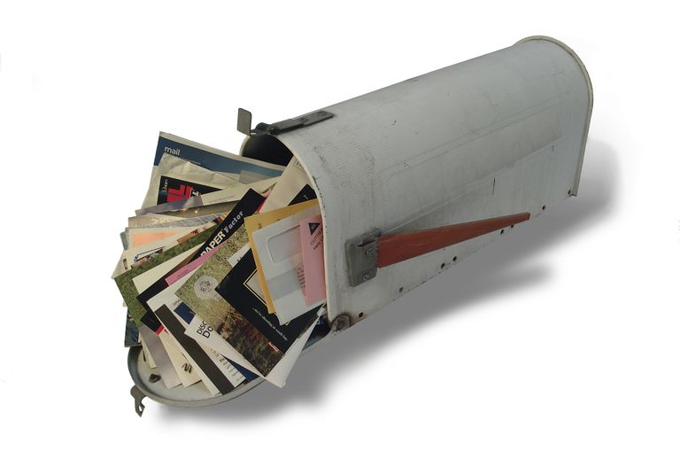 Mailbox stuffed with mail.