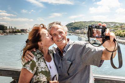 An older couple taking a selfie