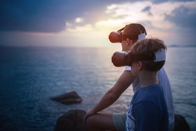 Father and Son viewing VR sunset
