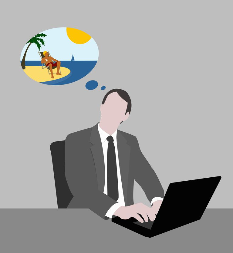 A businessman working at a desk and dreaming of being at the beach