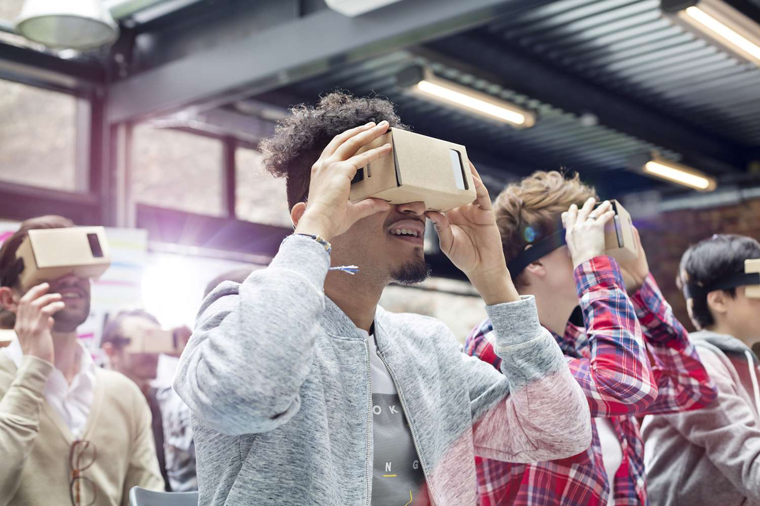 Person using virtual reality on iPhone.