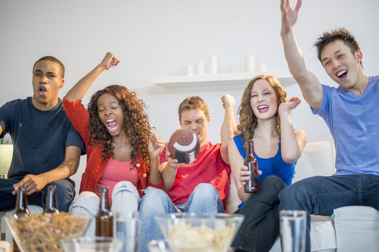 Group cheering at a Super Bowl party