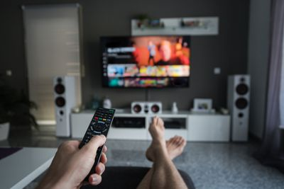 A person watching Netflix with their feet up in the living room
