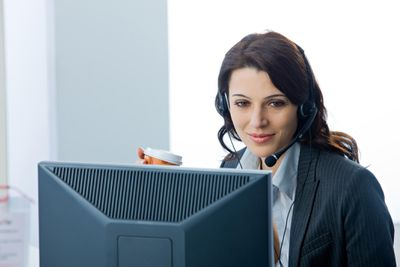 A marketing manager wearing a headset in an office