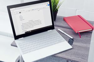 An indented paragraph in Google Docs on a laptop on a table