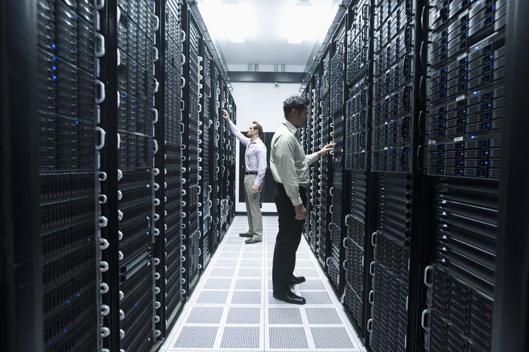 Men working in server room