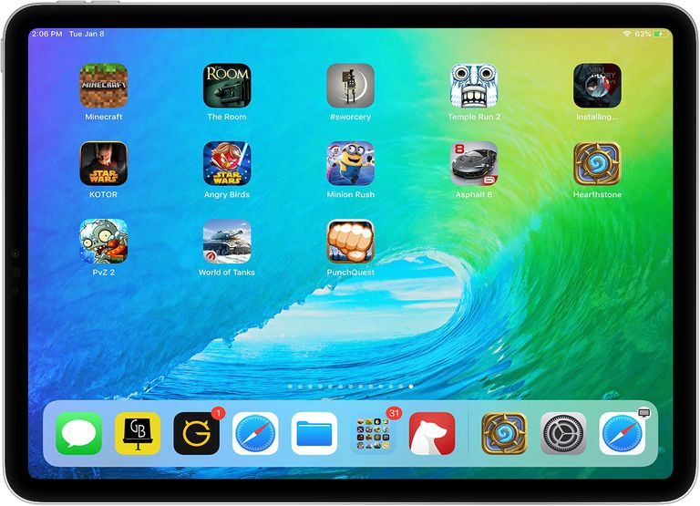 iPad with several best iPad games on it, including Hearthstone, Minecraft, The Room, and PunchQuest