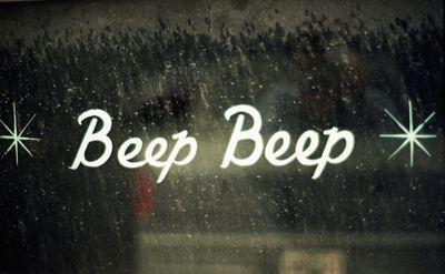 Beep beep text on a window