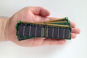 A hand holding RAM modules