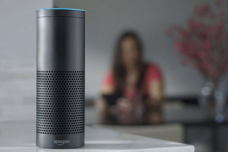 Amazon Alexa on countertop with woman in background