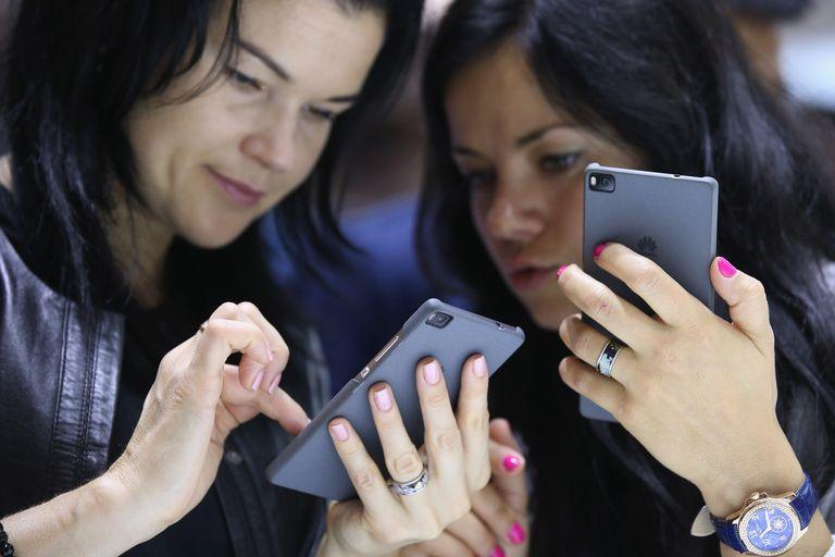 Two women on phones