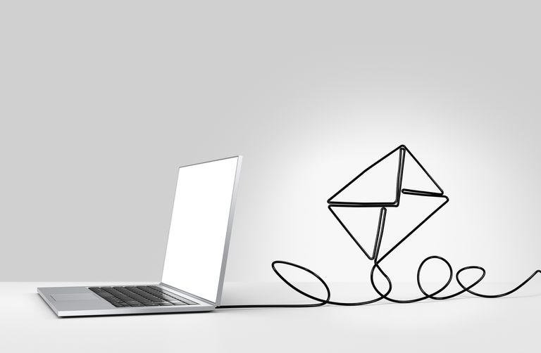 Illustrated envelope attached to a laptop, symbolizing email