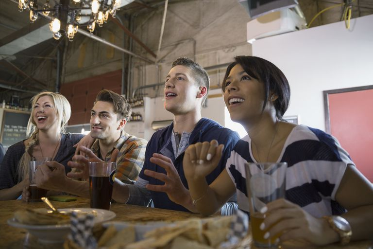 Friends watching sports in bar