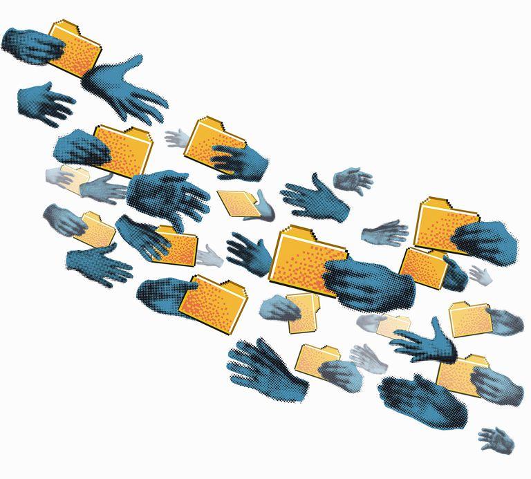 Hands exchanging folders