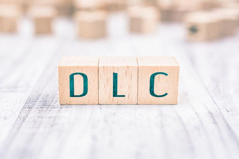 Wooden letter blocks spell out DLC