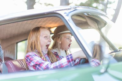 Two young girls in a car screaming