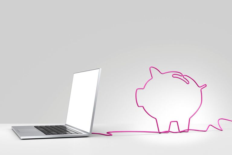 Laptop with pink cord that forms the shape of a piggy bank