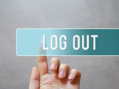 Person pressing log out button
