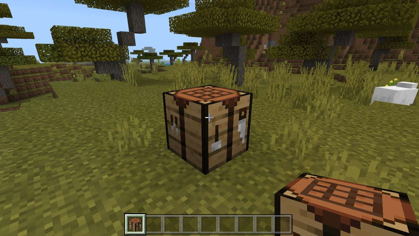 Place your crafting table on the ground and interact with it to access the 3X3 crafting grid.