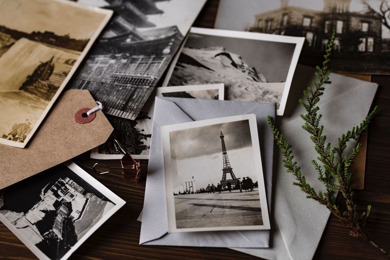 Old pictures spread around a table
