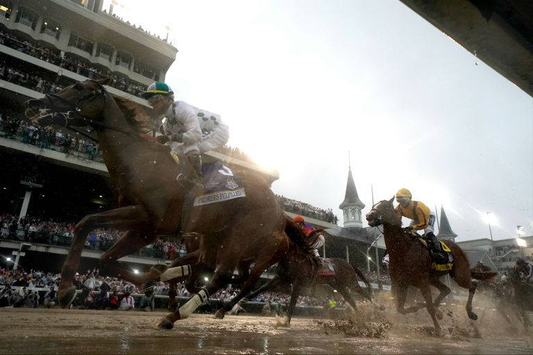Horses racing at the Kentucky Derby at Churchill Downs