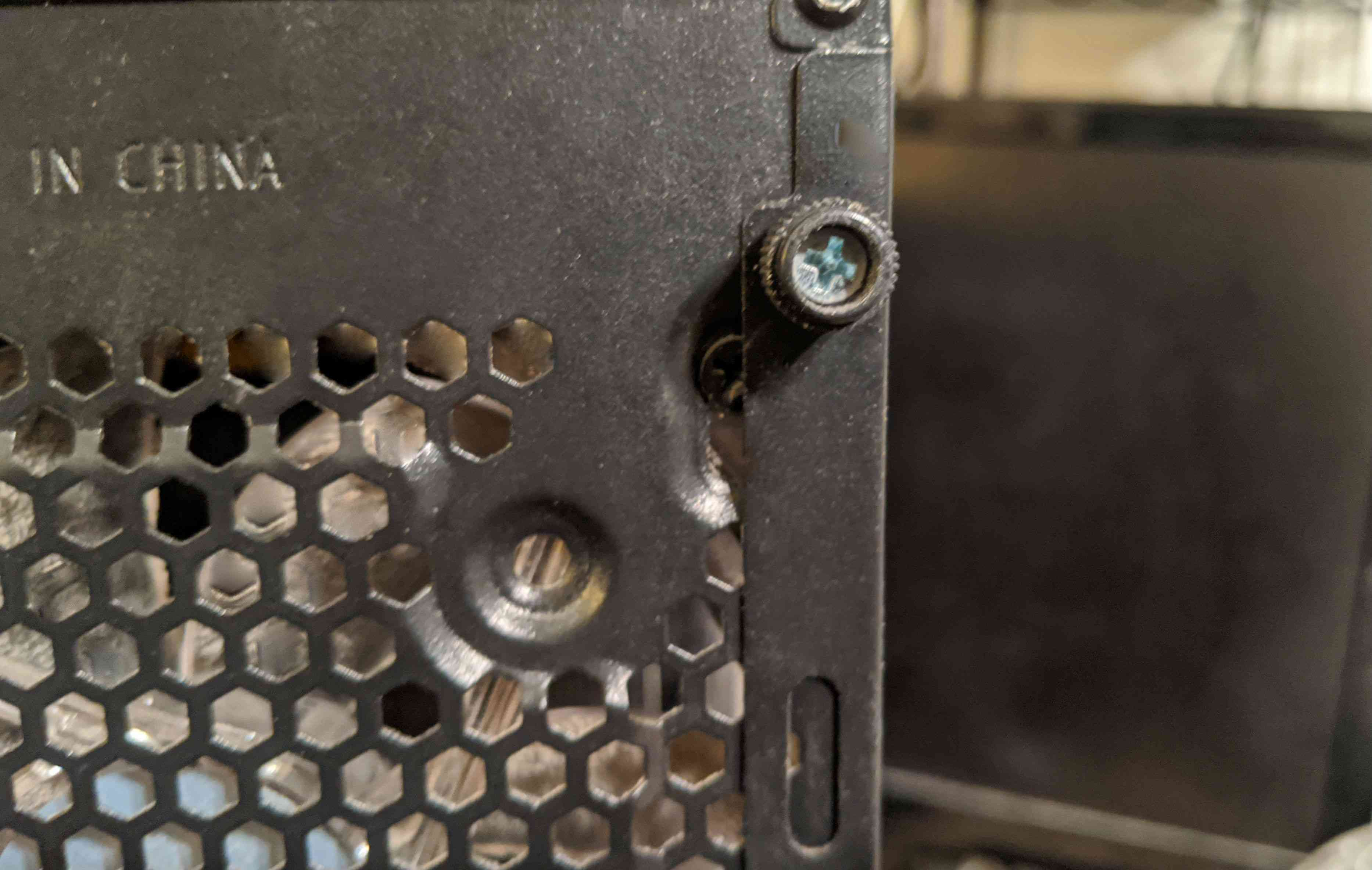 A thumbscrew on a computer case.