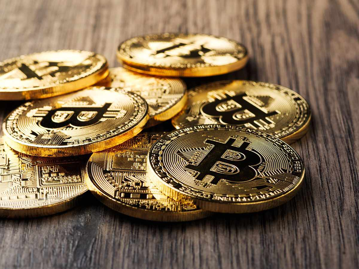 Close-up of bitcoins on table