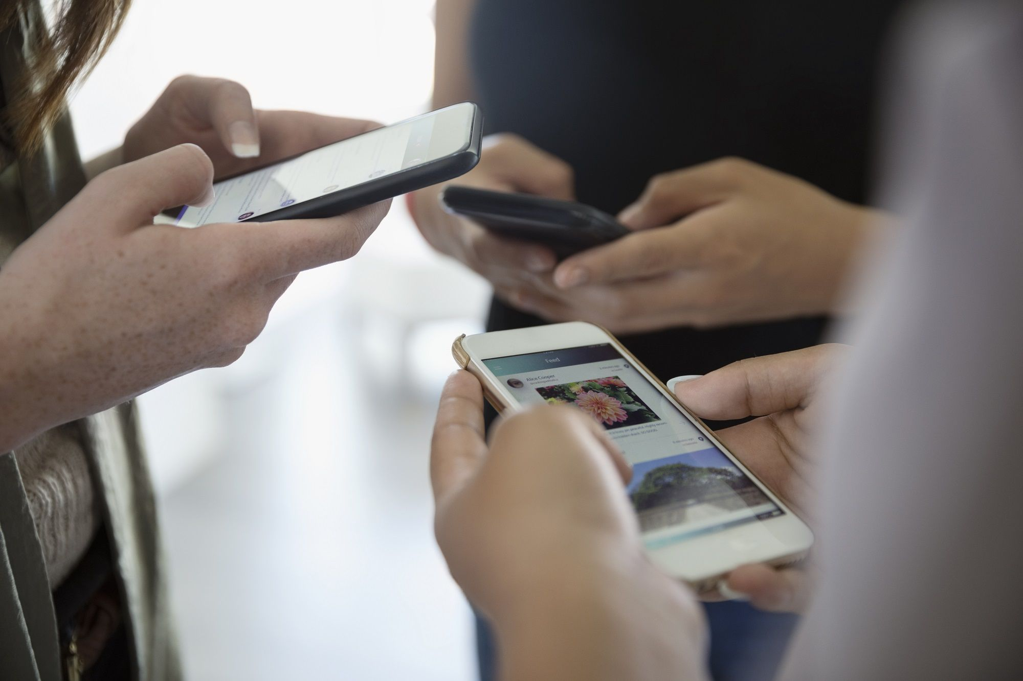 A group of people using text messaging.
