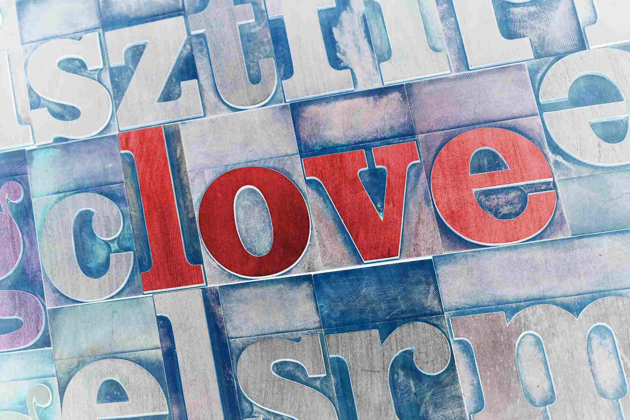 The word 'love' in red print blocks