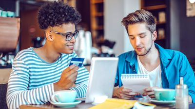 Two male students shopping for school supplies online