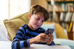 Image of a boy using a mobile phone
