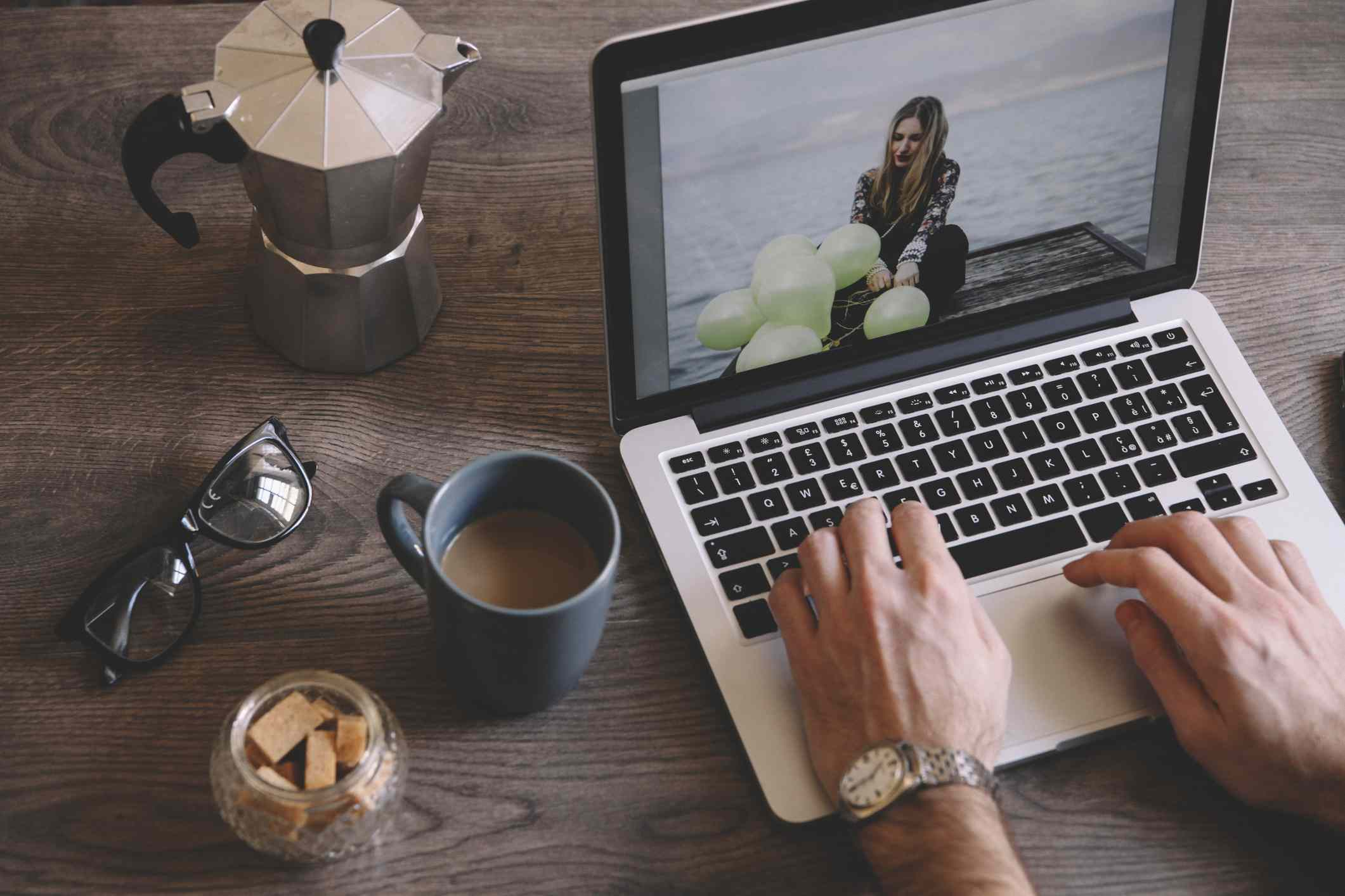 man using web graphics software on laptop