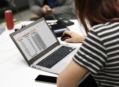 Woman using spreadsheet on a laptop