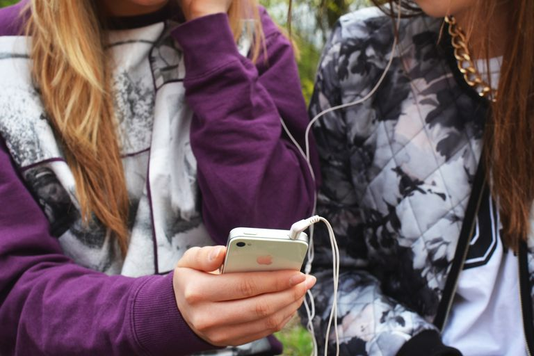 Girls listening to music on iPhone