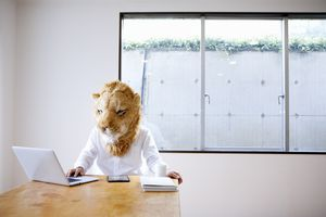 Person wearing as mask using laptop