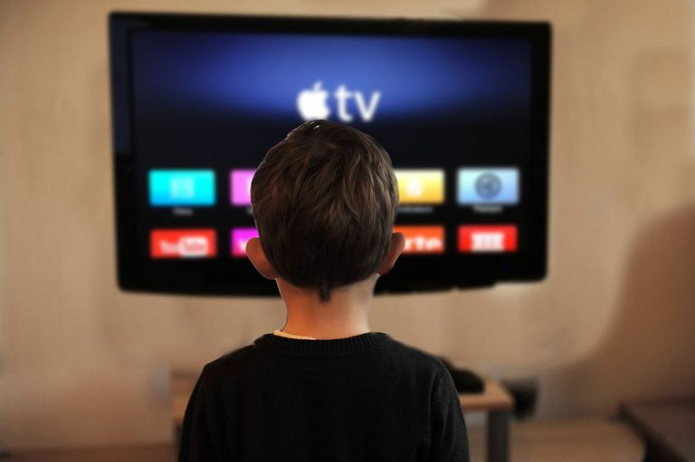 A boy watching Apple TV