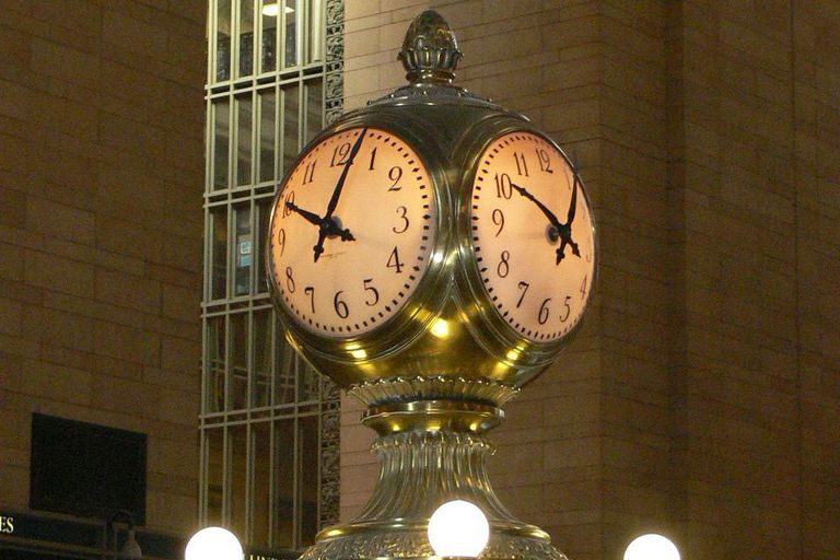 Two faces of the iconic four-faced clock inside Grand Central Terminal in New York City