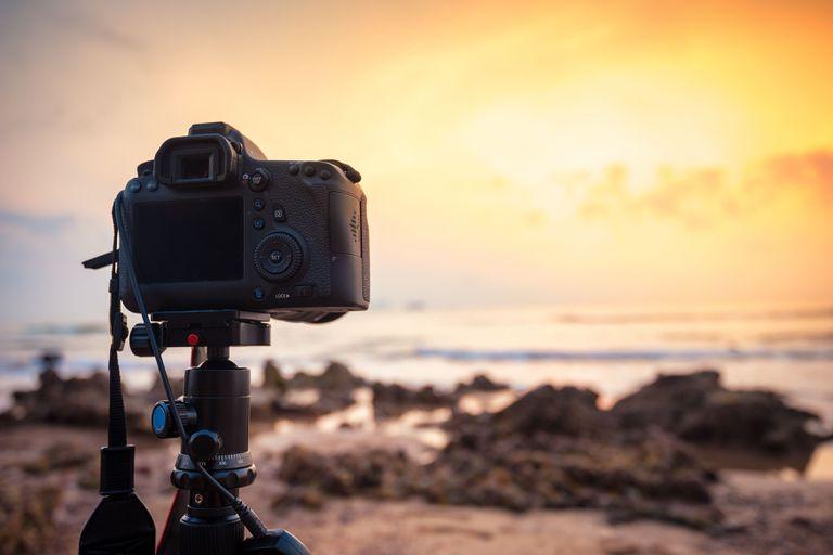 A digital camera on a tripod.