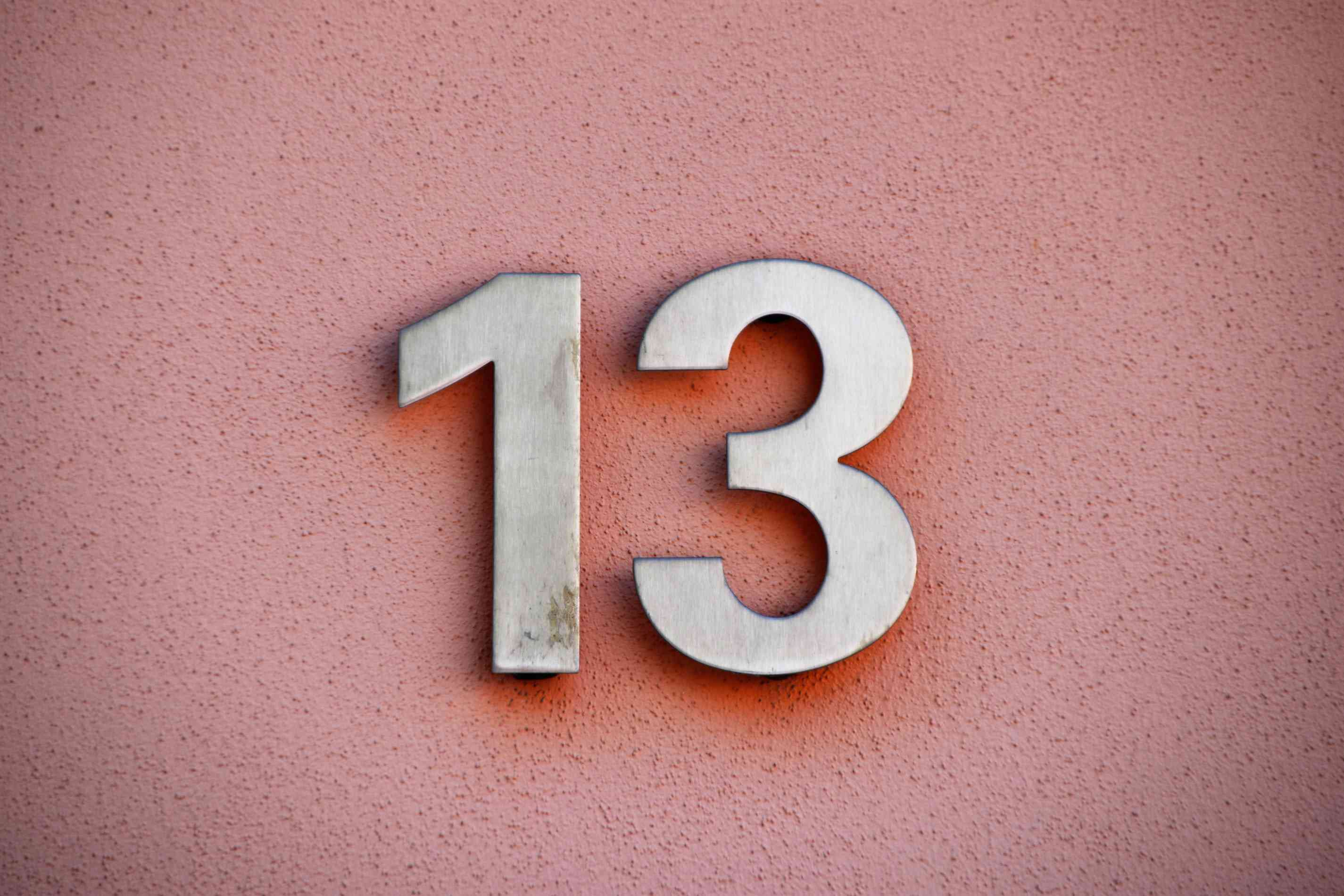 Number 13 sign on a wall