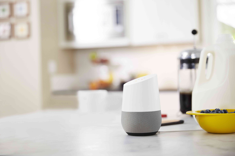 A Google Home smart speaker in a kitchen.
