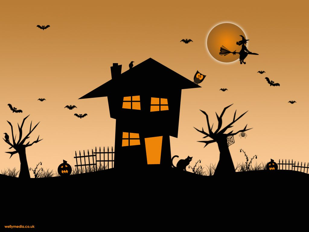 A haunted house with owls, bats, and a witch.
