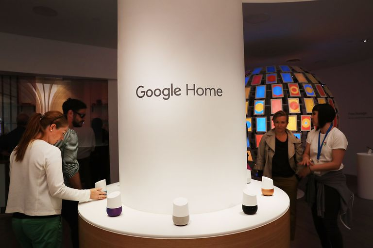 People walking around Google Home devices on display