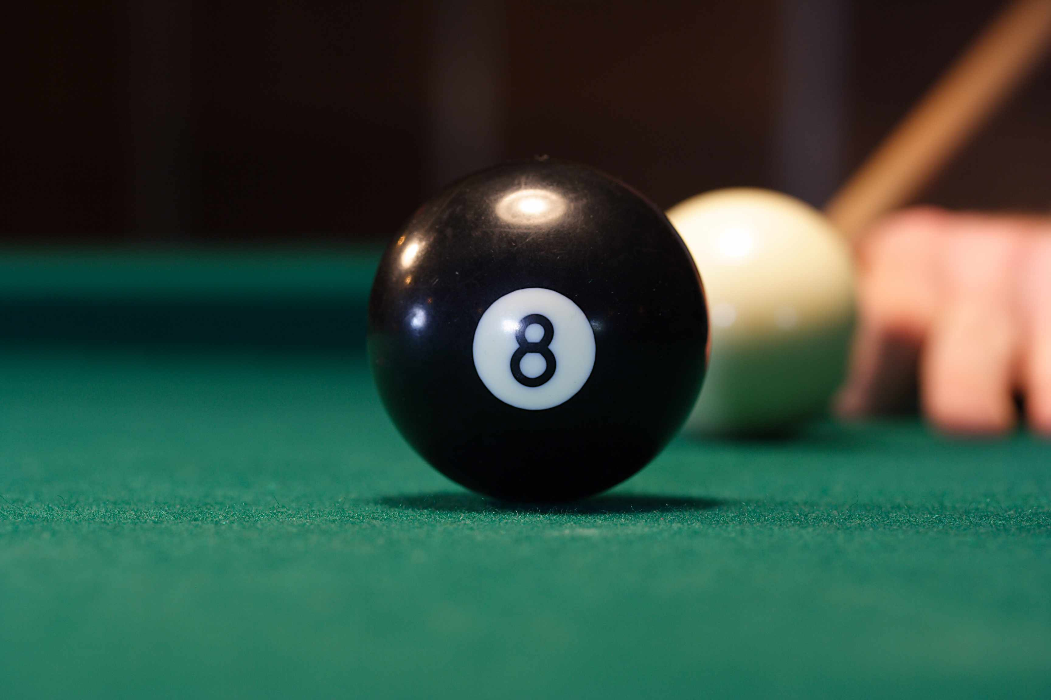 Eight ball centered on pool table